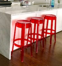Phillip Stark style red stools, 3 at $50 each