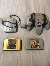 black Nintendo 64 with controllers and game cartridges 479 km