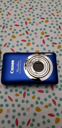 blue Canon point and shoot camera