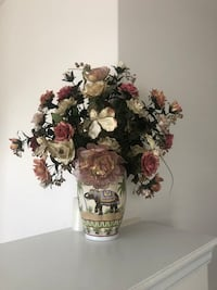 Beautiful veremic vadr with flower arrangement