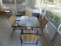 SOLD     black metal framed glass top table with chairs FOLEY