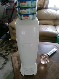 Diaper Genie practically new used a couple times comes with  810 bags
