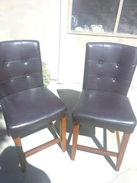 two black leather padded chairs Stockton, 95215