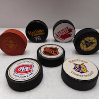 7 Hockey Puck Lot NHL, Canadiens, Timber Wolves, 10oz Trainer etc.. Ottawa