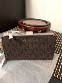 monogrammed brown and black Coach leather handbag Mississauga, L5A 2T1