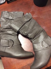 pair of gray leather 1-buckled knee-high boots