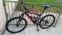 red and black full suspension mountain bike Los Angeles, 90002