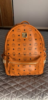 brown MCM leather backpack with belt Ajax, L1T 1X3