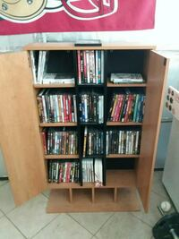 shelf with about 90 dvds Tracy, 95377
