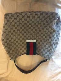Women's monogrammed gray gucci hobo bag