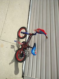 toddler's blue and red bicycle Toronto, M6H 3M3
