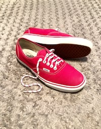 Vans low-top paid $65 size 10 good condition. Red & white shoe laces. Women's 11.5 very minor spotting on front other then that good condition.