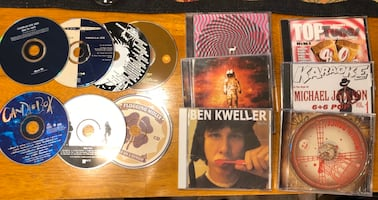 13 used music CD's - ok condition - $3 for all - porch pickup