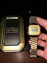 square gold-colored Casio digital watch with chain link bracelet