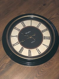 round black and white analog wall clock Montréal, H1T 1E5
