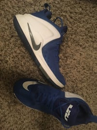 pair of blue-and-white Nike basketball shoes Jackson, 38305