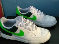 pair of white-black-and-green Nike Air Force 1 shoes
