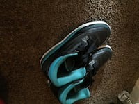 pair of black-and-teal Nike basketball shoes 2291 mi
