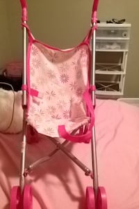 baby's pink stroller