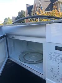 white General Electric microwave oven Winchester, 22602