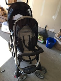 baby's black and gray stroller 729 km
