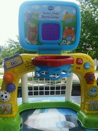 blue, yellow, and green Little Tikes basketball hoop 550 km