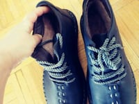 pair of black leather boots 541 km
