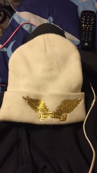 white and brown knit cap 367 mi