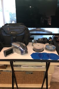 Canon Camcorder w/ charger, case & discs