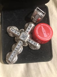 925 sterling silver cross with stones and case. Would make a great gift You can tell the size of it compared to the cap Selmer, 38375