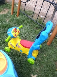 toddler's yellow, red, and teal plastic ride-on car toy