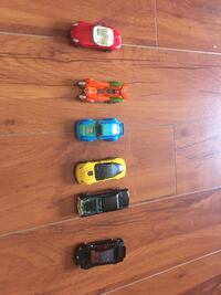 four assorted color plastic toy cars Mississauga, L5A 2Y4