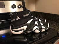black and white Adidas basketball sneakers