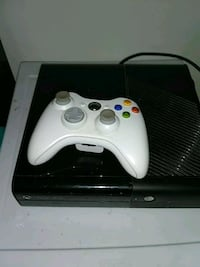 black Xbox 360 console with white controller