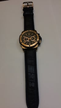 Round gold and black chronograph watch with black strap Gaithersburg, 20877