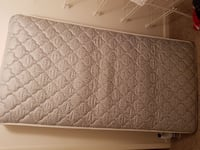 quilted grey and white mattress