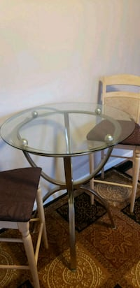 glass top table and two chairs set 38 mi