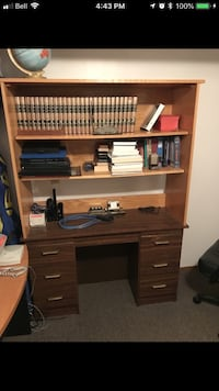 brown wooden single pedestal desk Edmonton, T6C 2B8
