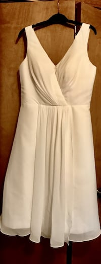 Elegant dress.  Never worn. Chiffon, ivory. Size 8-10. Purchased from Simply Bridal Monroe, 48161