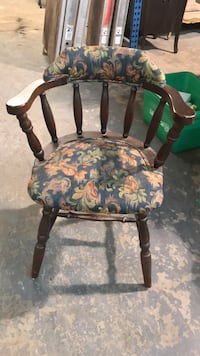brown wooden framed green and white floral padded armchair