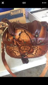 Brown leather horse saddle Purse