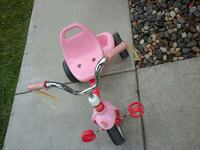girl's pink and red trike