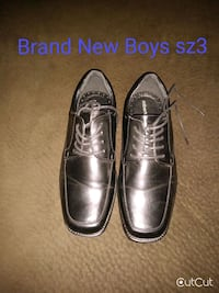 pair of black leather dress shoes San Angelo, 76904