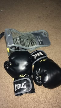 pair of black Everlast boxing gloves