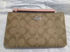 Brand New Coach Wristlet. Never been used.