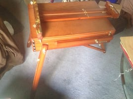 Wooden artist easel with supplies