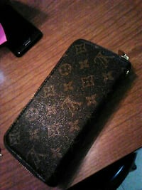 black and brown Louis Vuitton leather wristlet