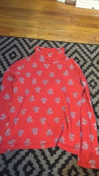 red turtle-neck sleeved shirt