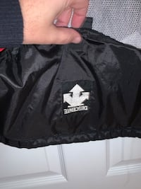 Bicycling Descente rain jacket. Black and red with breathable zip flap