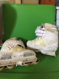 Pair of white-and-yellow inline skates